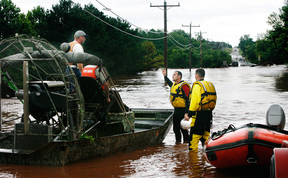 Photo - Rescuers using air boats and rafts at scene of a swift-water rescue on Hefner Road, west of Sooner. Torrential rain caused flooding in Oklahoma City, Monday, June 14, 2010.     by Jim Beckel, The Oklahoman