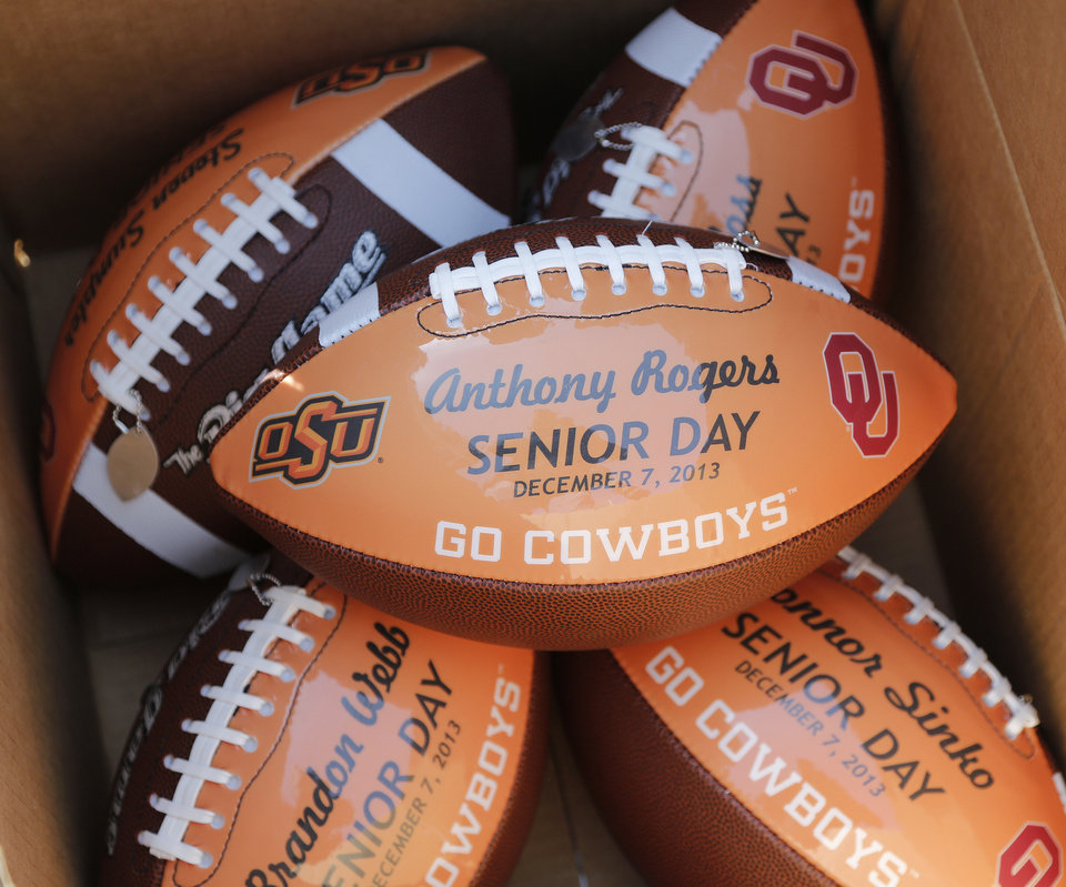 Senior day footballs during the Bedlam college football game between the Oklahoma State University Cowboys (OSU) and the University of Oklahoma Sooners (OU) at Boone Pickens Stadium in Stillwater, Okla., Saturday, Dec. 7, 2013. Photo by Chris Landsberger, The Oklahoman