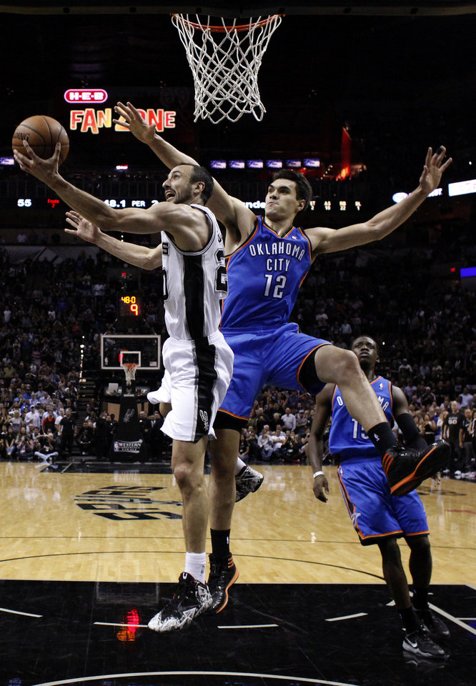Photo - San Antonio's Manu Ginobili (20) shoots a lay up as Oklahoma City's Steven Adams (12) defends during Game 2 of the Western Conference Finals in the NBA playoffs between the Oklahoma City Thunder and the San Antonio Spurs at the AT&T Center in San Antonio, Wednesday, May 21, 2014. Photo by Sarah Phipps