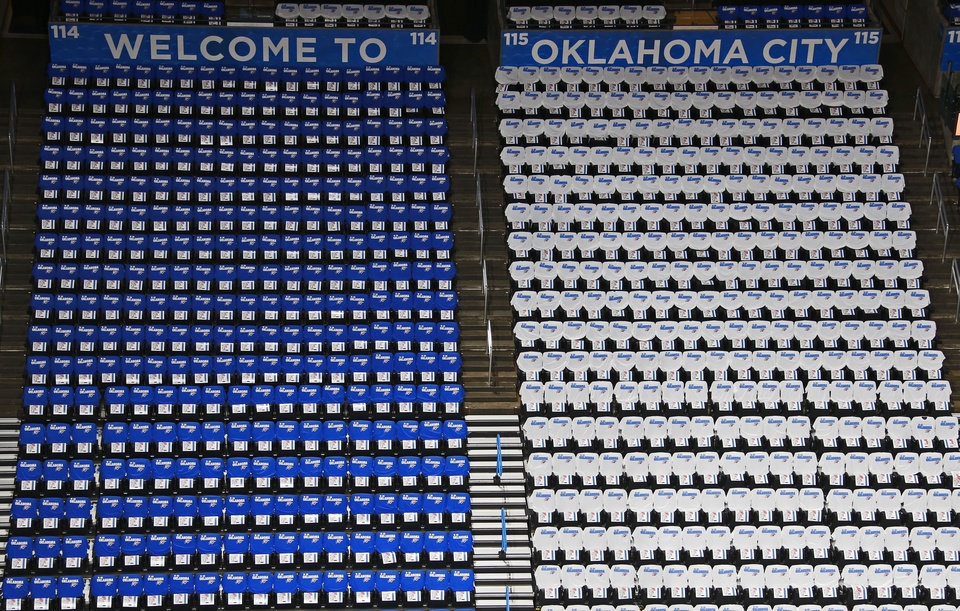 Photo - Blue and white shirts cover the seats inside Chesapeake Energy Arena before Game 2 of the Western Conference semifinals in the NBA playoffs between the Oklahoma City Thunder and the Los Angeles Clippers at Chesapeake Energy Arena in Oklahoma City, Wednesday, May 7, 2014. Photo by Bryan Terry, The Oklahoman