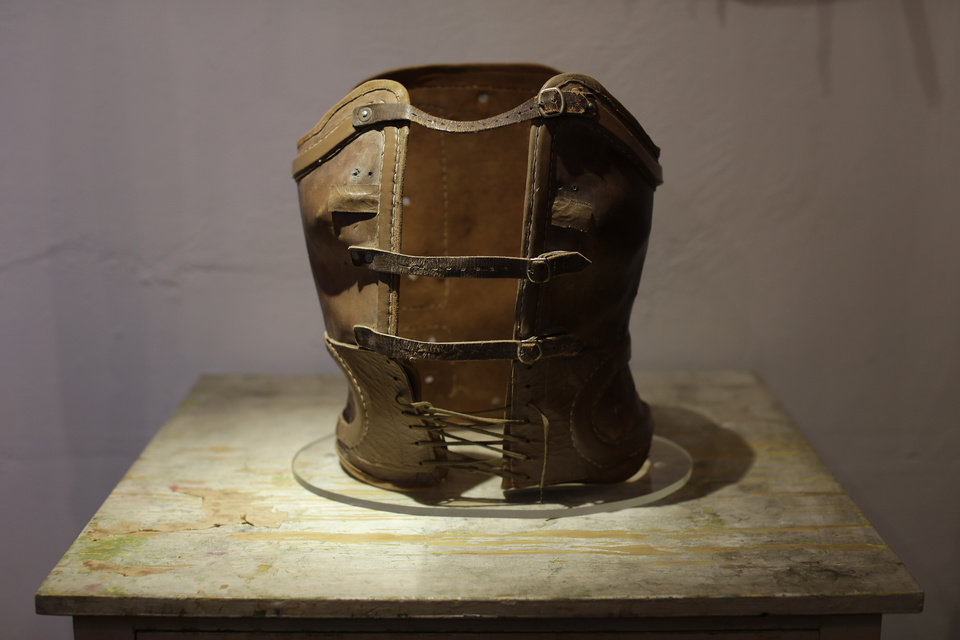 Photo -   A leather corset that belonged to late Mexican artist Frida Kahlo is displayed at the Frida Kahlo museum in Mexico City, Tuesday, Oct. 2, 2012. A full collection from Kahlo's wardrobe will go on public display Nov. 22 in Mexico City after being locked for nearly 50 years in her armoires and dressers: jewelry, shoes and clothes that still carry the scent of the late artist's perfume and cigarette smoke or stains from painting. Her loose blouses covered the stiff corsets she wore for back pain. (AP Photo/Dario Lopez-Mills)
