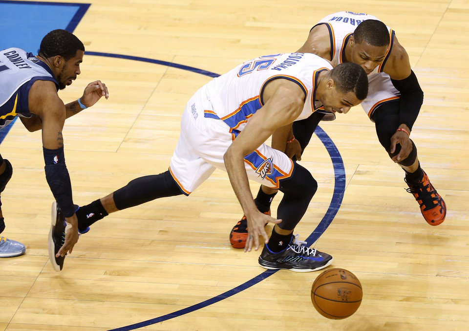 Photo - Oklahoma City's Thabo Sefolosha (25). and Russell Westbrook (0) go for the ball in front of Memphis' Mike Conley (11) during Game 5 in the first round of the NBA playoffs between the Oklahoma City Thunder and the Memphis Grizzlies at Chesapeake Energy Arena in Oklahoma City, Tuesday, April 29, 2014. Photo by Nate Billings, The Oklahoman