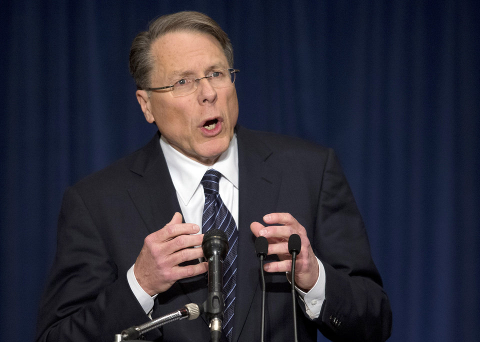 The National Rifle Association executive vice president Wayne LaPierre, gestures during a news conference in response to the Connecticut school shooting on Friday, Dec. 21, 2012 in Washington. The nation\'s largest gun-rights lobby is calling for armed police officers to be posted in every American school to stop the next killer