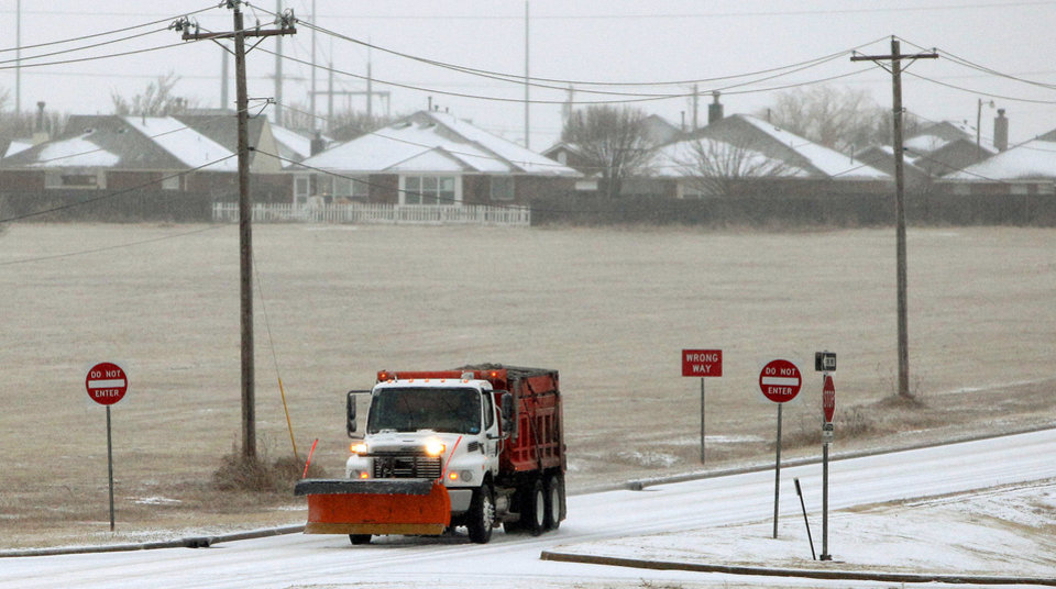 Photo - An Oklahoma Transportation Authority truck drives through sleet on Memorial Road in Oklahoma City, Thursday, Jan. 28, 2010.  Photo by Bryan Terry, The Oklahoman