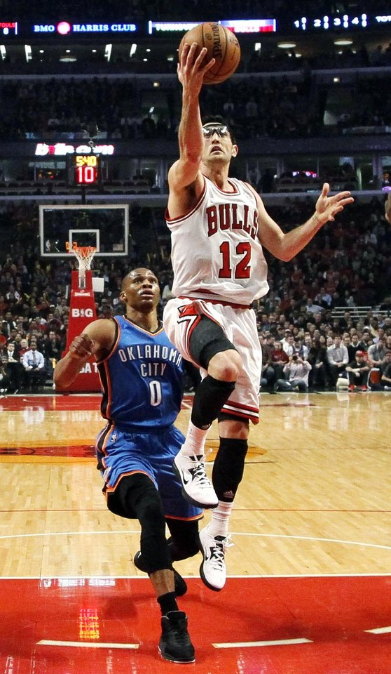 Chicago Bulls guard Kirk Hinrich (12) shoots past Oklahoma City Thunder guard Russell Westbrook (0) during the first half of an NBA basketball game, Thursday, Nov. 8, 2012, in Chicago. (AP Photo/Charles Rex Arbogast) ORG XMIT: CXA108