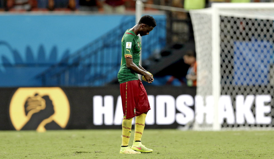 Photo - Cameroon's Nicolas N'Koulou leaves the field after the group A World Cup soccer match between Cameroon and Croatia at the Arena da Amazonia in Manaus, Brazil, Wednesday, June 18, 2014. Croatia won the match 4-0. (AP Photo/Dolores Ochoa)