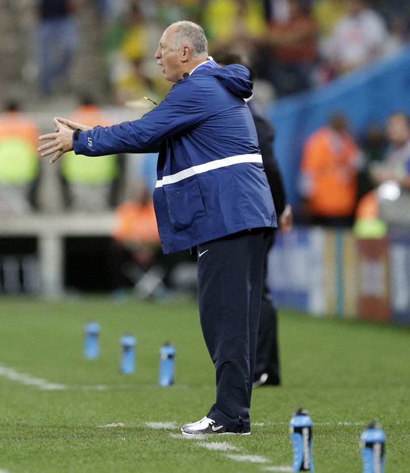 Photo - Brazil's coach Luiz Felipe Scolari shouts instructions to his team during the group A World Cup soccer match between Brazil and Croatia, the opening game of the tournament, in the Itaquerao Stadium in Sao Paulo, Brazil, Thursday, June 12, 2014.  (AP Photo/Andre Penner)
