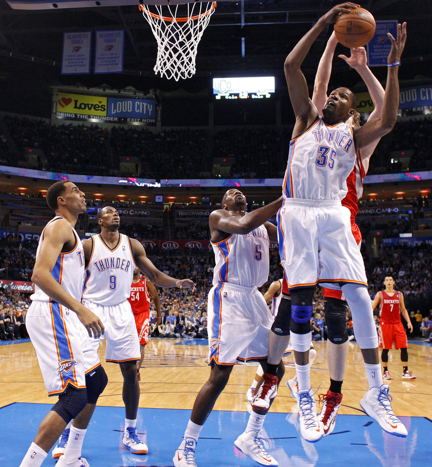 Oklahoma City 's Kevin Durant (35) gets a rebound during the NBA basketball game between the Houston Rockets and the Oklahoma City Thunder at the Chesapeake Energy Arena on Wednesday, Nov. 28, 2012, in Oklahoma City, Okla.   Photo by Chris Landsberger, The Oklahoman