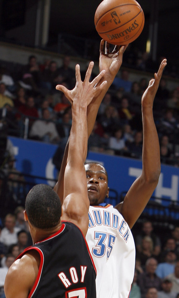 Photo - Oklahoma City's Kevin Durant (35) shoots over Portland's Brandon Roy (7) during the NBA game between the Oklahoma City Thunder and the Portland Trail Blazers, Sunday, Nov. 1, 2009, at the Ford Center in Oklahoma City. Photo by Sarah Phipps, The Oklahoman