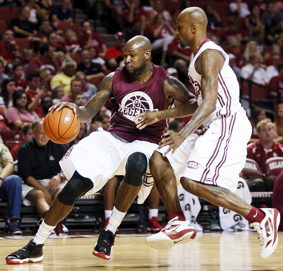 Photo - Ebi Ere, left, dribbles against Tony Crocker during the OU Legends Alumni Game in Lloyd Noble Center in Norman, Okla., Saturday, Aug. 23, 2014. The game is part of the Sooner Basketball Family Weekend. Photo by Nate Billings, The Oklahoman