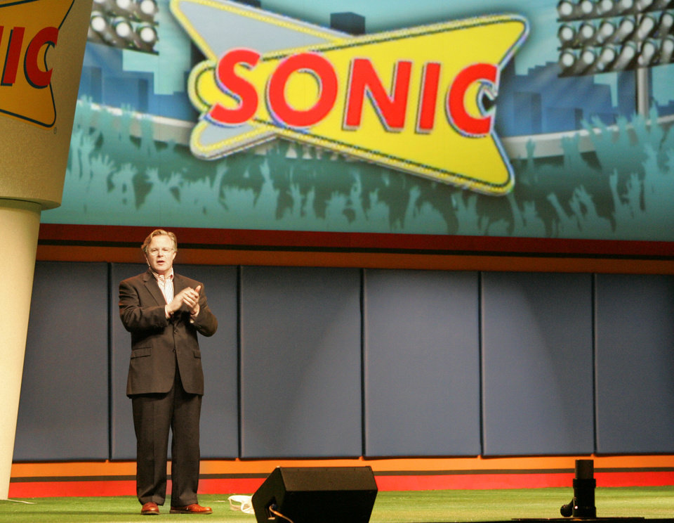 Photo -  Sonic Chairman and CEO Cliff Hudson speaks during Sonic's annual convention at the Cox Center in Oklahoma City, Okla. Sept. 12, 2007. BY STEVE GOOCH, THE OKLAHOMAN ORG XMIT: KOD