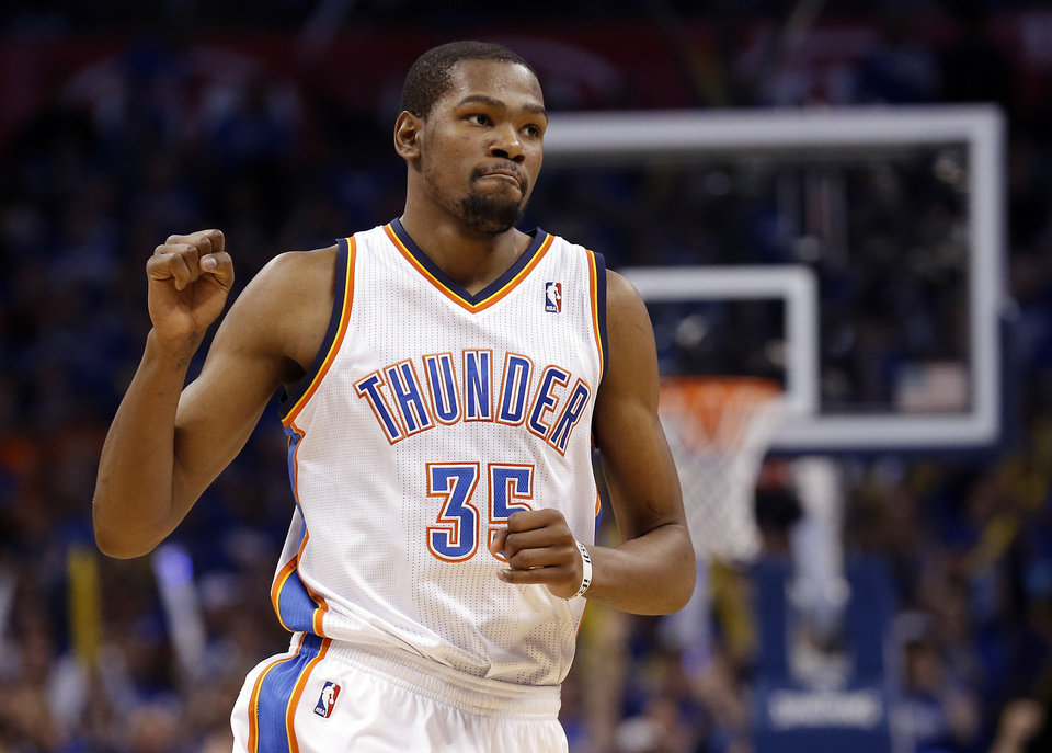 Photo - Oklahoma City's Kevin Durant (35) celebrates during Game 1 in the second round of the NBA playoffs between the Oklahoma City Thunder and the Memphis Grizzlies at Chesapeake Energy Arena in Oklahoma City, Sunday, May 5, 2013. Photo by Sarah Phipps, The Oklahoman
