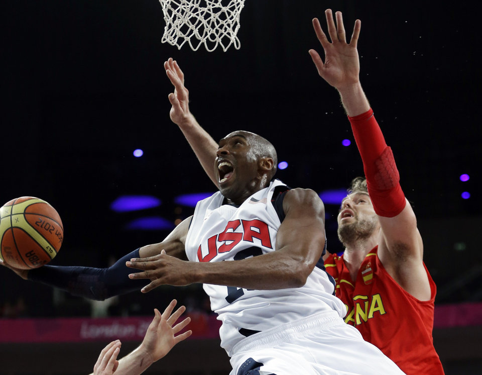 United States' Kobe Bryant  shoots past Spain's Pau Gasol during a men's gold medal basketball game at the 2012 Summer Olympics, Sunday, Aug. 12, 2012, in London. (AP Photo/Eric Gay)