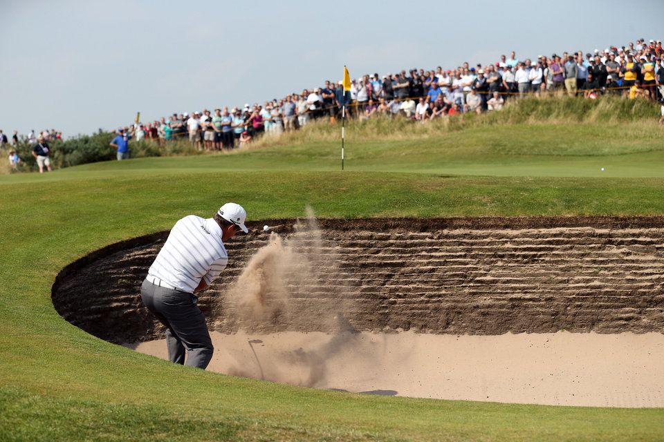 Photo - Lee Westwood of England plays out of the bunker onto the 6th green during the second day of the British Open Golf championship at the Royal Liverpool golf club, Hoylake, England, Friday July 18, 2014. (AP Photo/Peter Morrison)