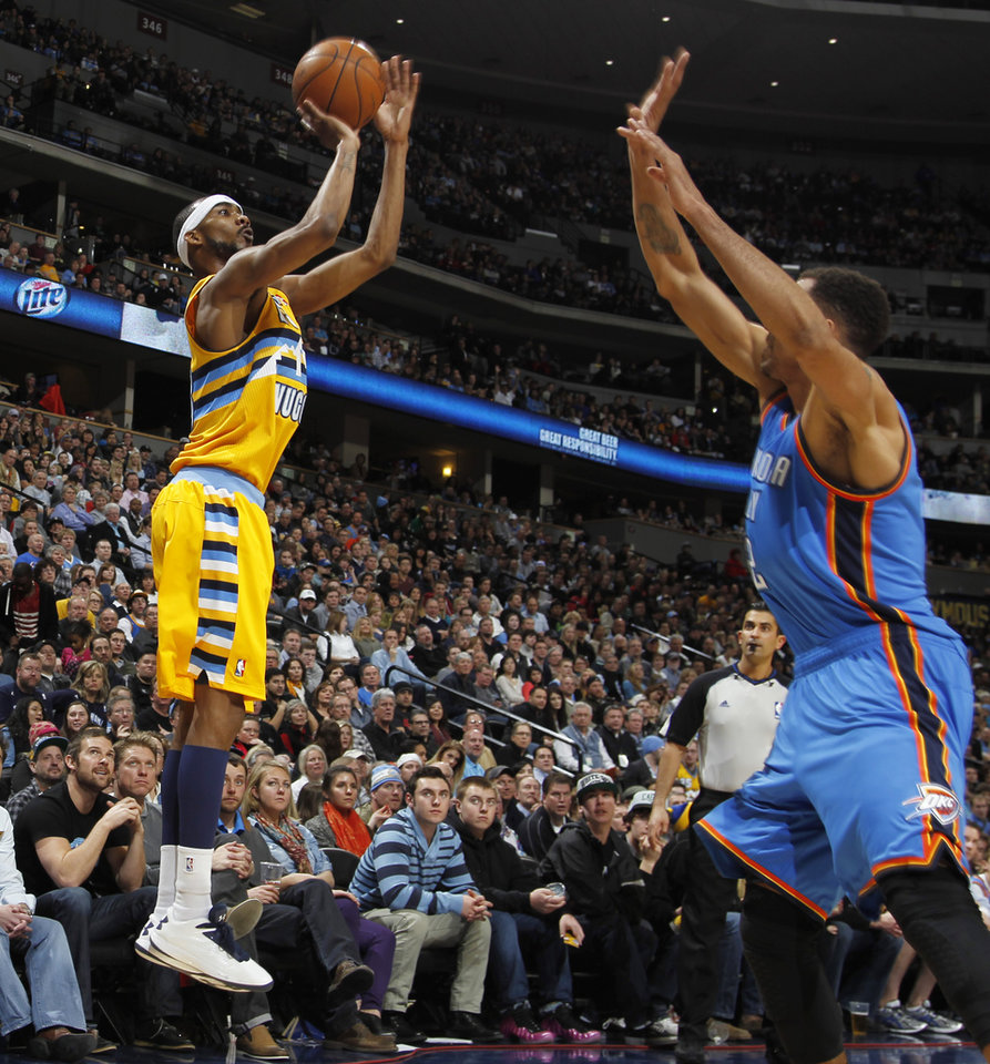 Denver Nuggets guard Corey Brewer, left, shoots a 3-pointer over Oklahoma City Thunder guard Thabo Sefolosha, of Switzerland, in the fourth quarter of their NBA basketball game in Denver, Sunday, Jan. 20, 2013. The Nuggets won 121-118 in overtime. (AP Photo/David Zalubowski)