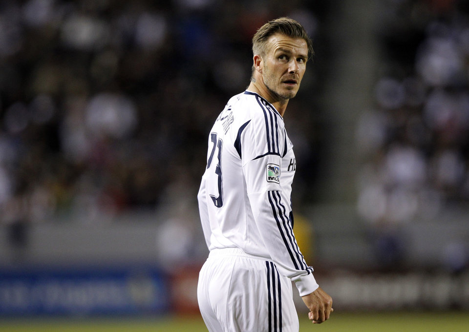 Photo -   FILE - In this Nov. 4, 2012 file photo, Los Angeles Galaxy midfielder David Beckham of England looks up at the crowd while playing against San Jose Earthquakes during the first half of their MLS playoff soccer match in Carson, Calif. Football Federation Australia says it has received an approach by an agent representing the management of former England captain David Beckham to play some matches with an A-League team this season. (AP Photo/Alex Gallardo, File)