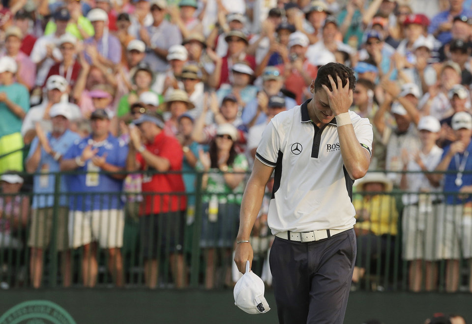 Photo - Martin Kaymer, of Germany rects after winning  the U.S. Open golf tournament in Pinehurst, N.C., Sunday, June 15, 2014.  (AP Photo/Charles Riedel)
