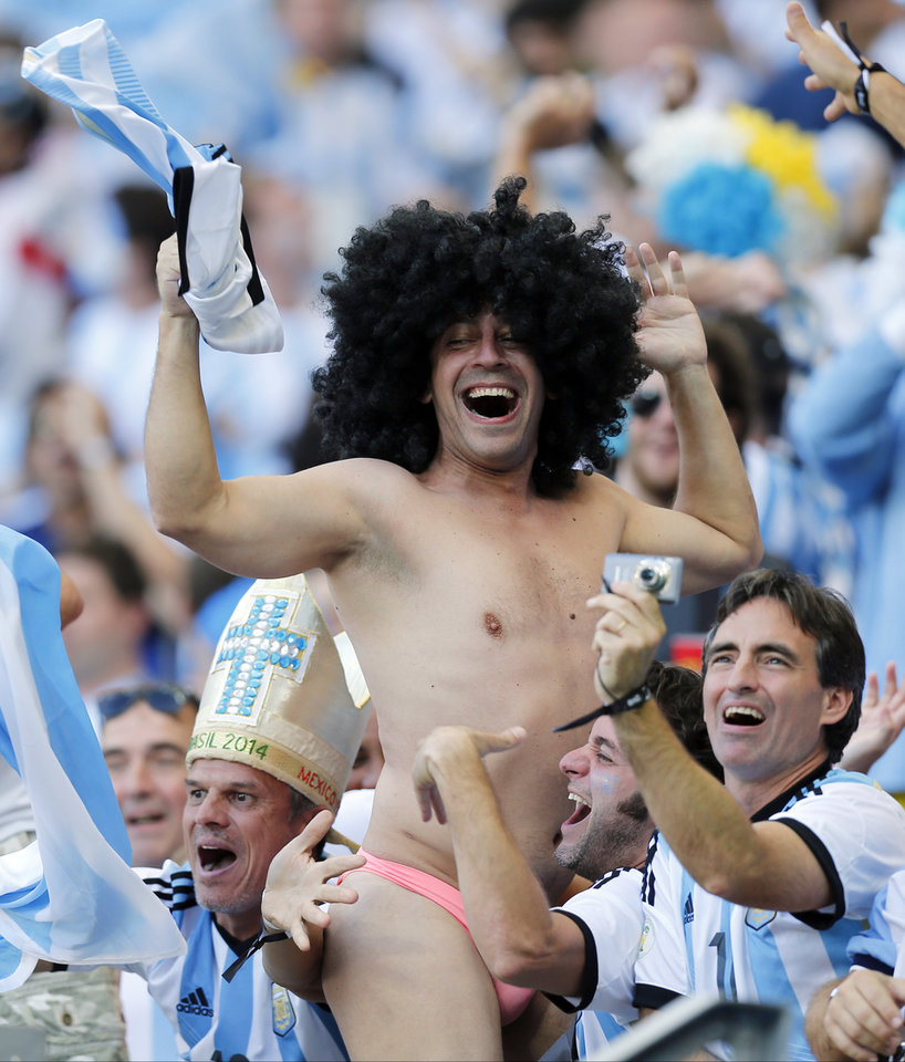 Photo - Argentine fans celebrate after the group F World Cup soccer match between Argentina and Iran at the Mineirao Stadium in Belo Horizonte, Brazil, Saturday, June 21, 2014. Argentina won the match 1-0. (AP Photo/Victor R. Caivano)