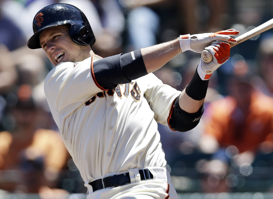 Photo - San Francisco Giants' Buster Posey grimaces  as he grounds out against the Miami Marlins during the fourth inning of a baseball game on Saturday, June 22, 2013, in San Francisco. (AP Photo/Marcio Jose Sanchez)