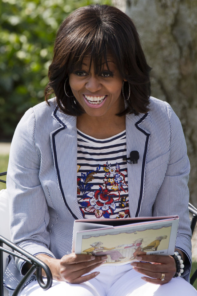 "First lady Michelle Obama smiles before reading the book ""Cloudy With A Chance of Meatballs"" as part of the annual White House Easter Egg Roll, Monday, April 1, 2013,  on the South Lawn of the White House in Washington. (AP Photo/Jacquelyn Martin)"