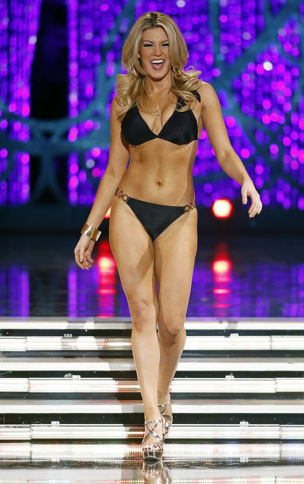 Photo - Miss New York Mallory Hytes Hagan competes swimsuit portion of the Miss America pageant on Saturday, Jan. 12, 2013, in Las Vegas. (AP Photo/Isaac Brekken)