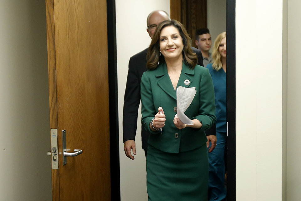 Photo - State schools superintendent Joy Hofmeister enters the room before a press conference announcing that the criminal case against against her has been dropped in Oklahoma City, Tuesday, Aug. 1, 2017. Photo by Bryan Terry, The Oklahoman
