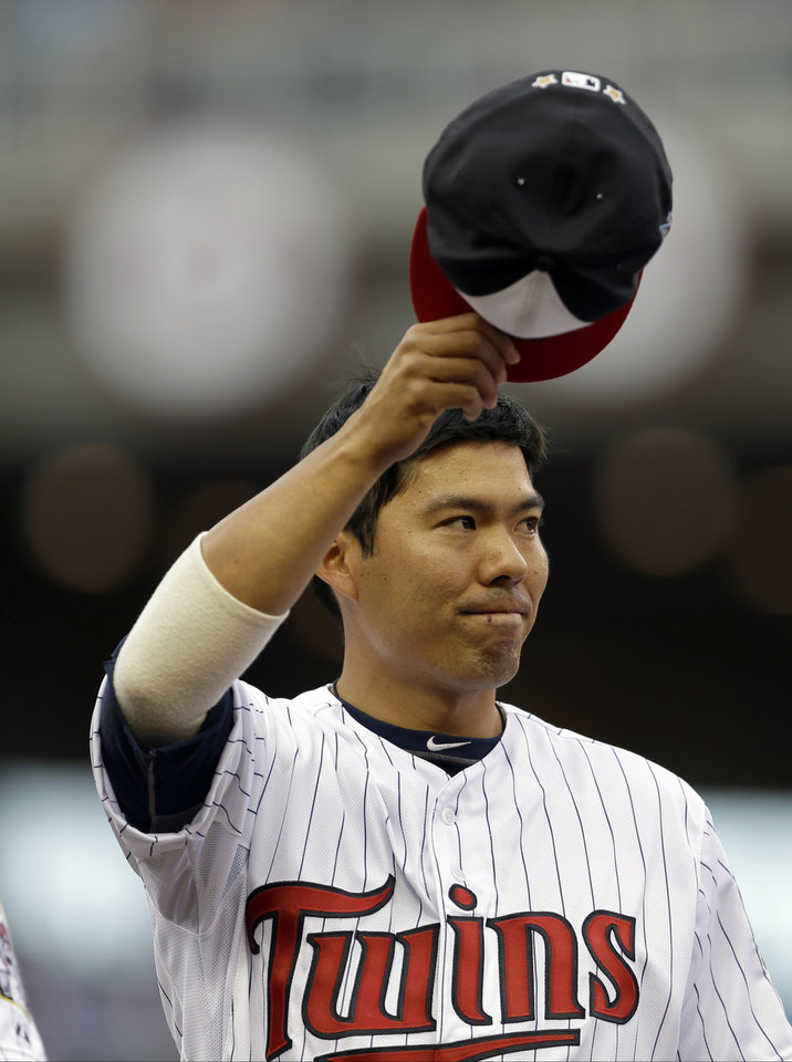 Photo - American League catcher Kurt Suzuki, of the Minnesota Twins, waves before the MLB All-Star baseball game, Tuesday, July 15, 2014, in Minneapolis. (AP Photo/Jeff Roberson)