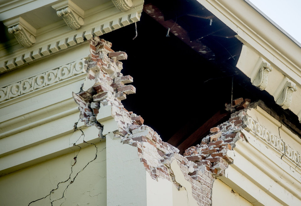 Photo - A corner of the historic Napa County Courthouse sits exposed following an earthquake Sunday, Aug. 24, 2014, in Napa, Calif. Officials in the city of Napa say 15 to 16 buildings are no longer inhabitable after Sunday's magnitude-6.0 earthquake, and there is only limited access to numerous other structures. (AP Photo/Noah Berger)