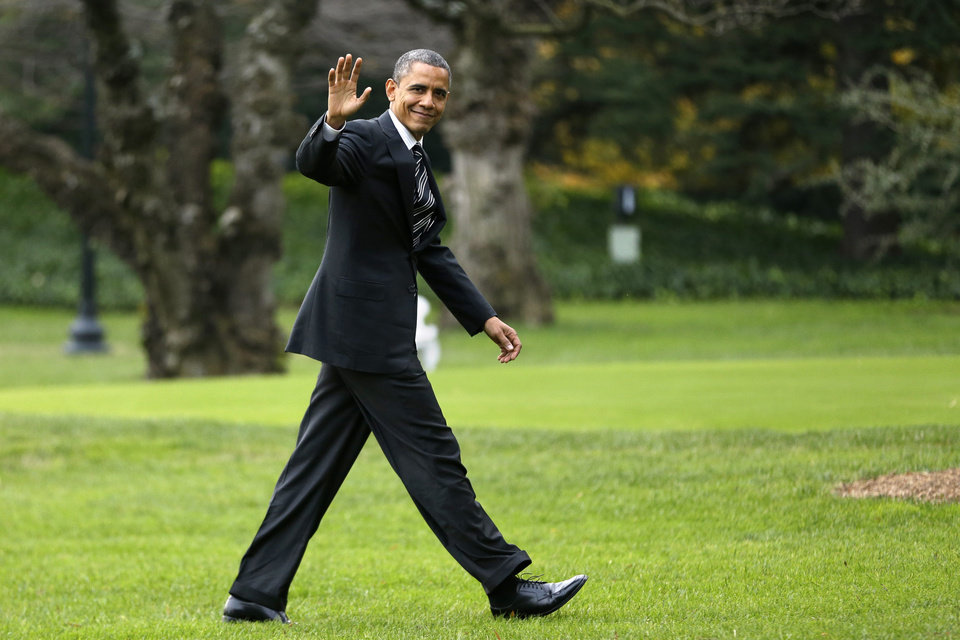 President Barack Obama waves as he returns to the White House in Washington, Thursday, Nov. 15, 2012, after visiting Superstorm Sandy affected areas in New York. (AP Photo/Jacquelyn Martin)