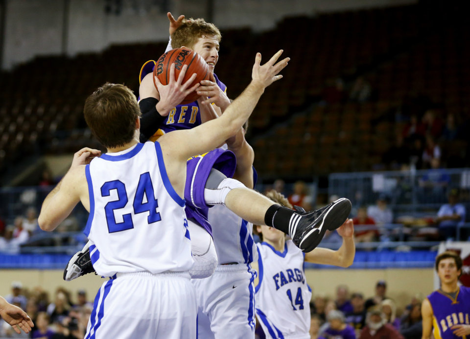 Photo - Red Oak's Tyler Parks leaps to the basket past Fargo's Derek Harrington during a Class B Boys game of the state high school basketball tournament between Fargo and Red Oak at the State Fair Arena at State Fair Park in Oklahoma City, Thursday, Feb. 28, 2013. Photo by Bryan Terry, The Oklahoman