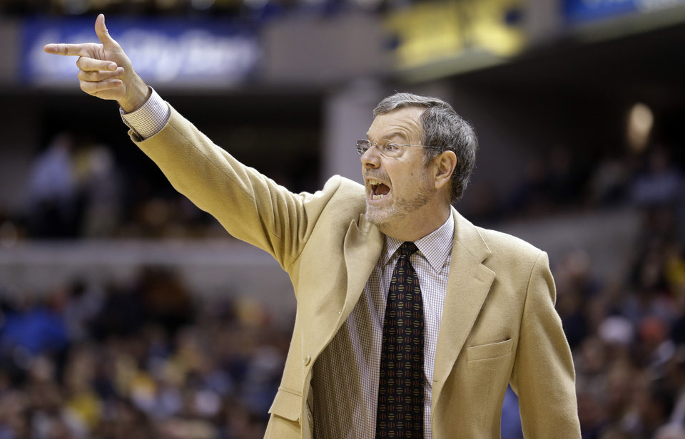 Brooklyn Nets head coach P.J. Carlesimo calls a play for his team as they played the Indiana Pacers in the first half of an NBA basketball game in Indianapolis, Monday, Feb. 11, 2013.  (AP Photo/Michael Conroy)