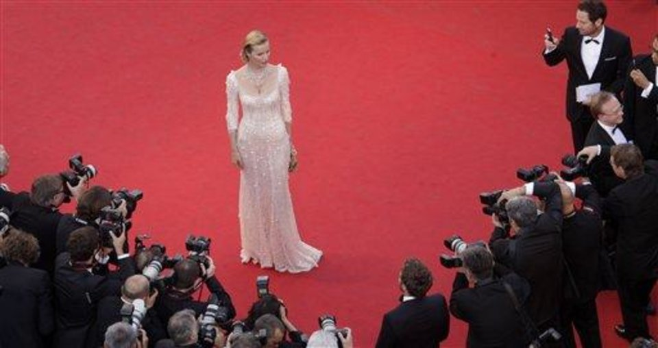 Photo - Model Eva Herzigova poses for photographers during the opening ceremony and screening of Moonrise Kingdom at the 65th international film festival, in Cannes, southern France, Wednesday, May 16, 2012. Herzigova is wearing a dress by Dolce & Gabbana. (AP Photo/Virginia Mayo, Pool)