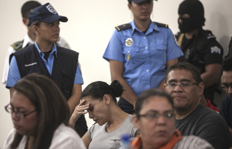 CORRECTS YEAR - Mexican citizen Raquel Alatorre Correa, alleged member of an organized crime group, gestures during the reading of the sentence for her and 17 others at court in Managua, Nicaragua, Friday, Jan. 18, 2013. A Nicaraguan judge has sentenced 18 Mexicans who posed as a television crew to 30 years in prison for drug trafficking and money laundering stemming from $9.2 million found in their news vans. (AP Photo/Mayerling Garcia)