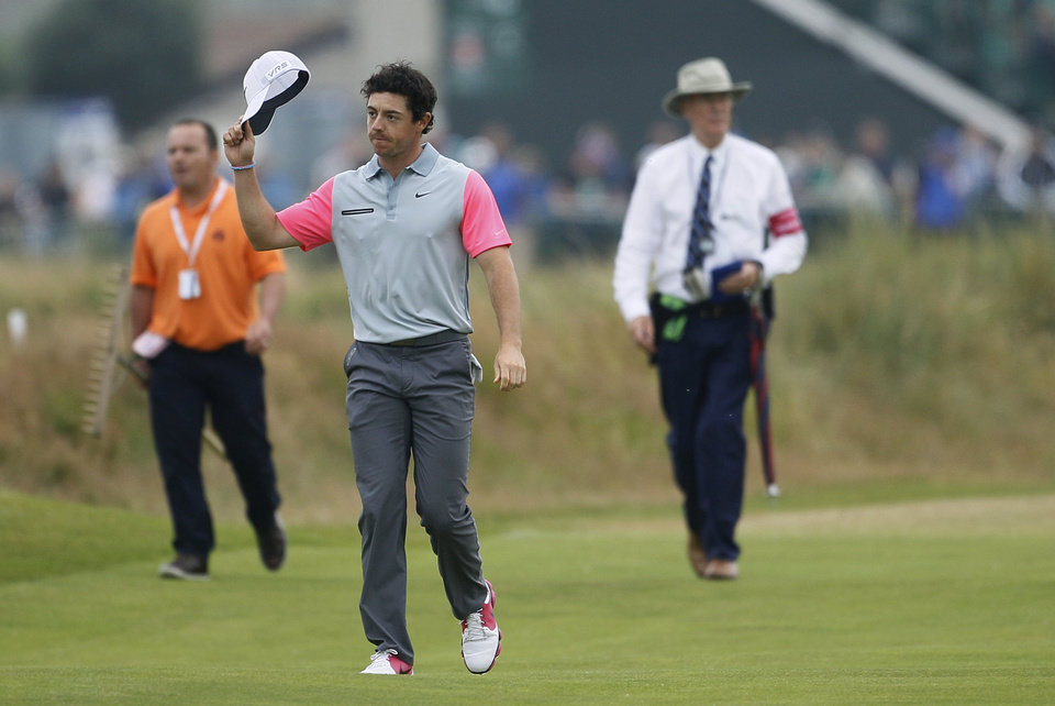 Photo - Rory McIlroy of Northern Ireland acknowledges the crowd as he walks up to the 18th green during the final round of the British Open Golf championship at the Royal Liverpool golf club, Hoylake, England, Sunday July 20, 2014. (AP Photo/Peter Morrison)