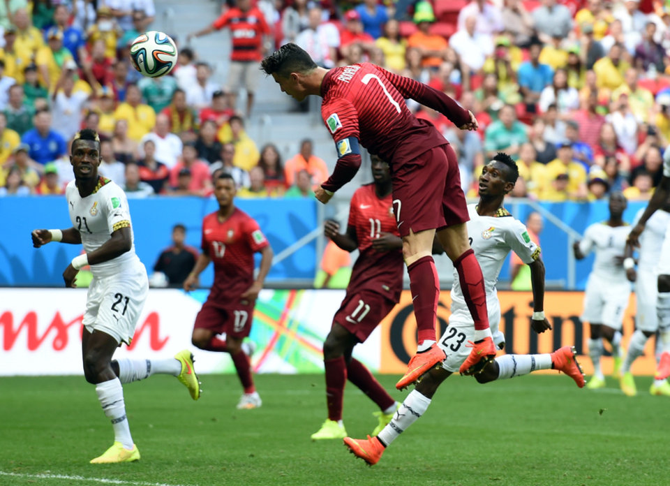 Photo - Portugal's Cristiano Ronaldo takes a header on goal during the group G World Cup soccer match between Portugal and Ghana at the Estadio Nacional in Brasilia, Brazil, Thursday, June 26, 2014. (AP Photo/Paulo Duarte)