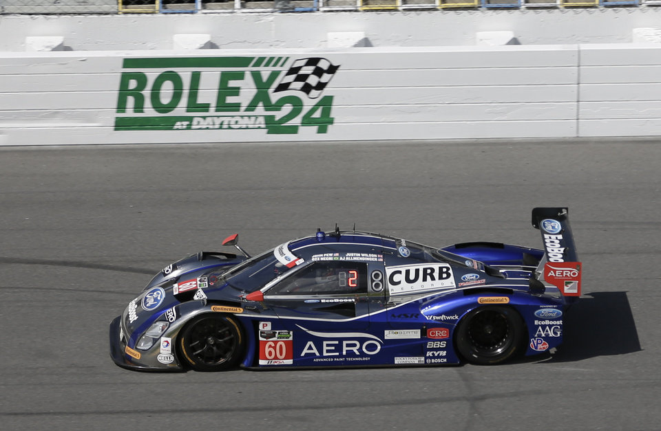 Photo - The Michael Shank Racing Riley DP heads along the front stretch during practice for the IMSA Series Rolex 24 hour auto race at Daytona International Speedway in Daytona Beach, Fla., Friday, Jan. 24, 2014. (AP Photo/John Raoux)