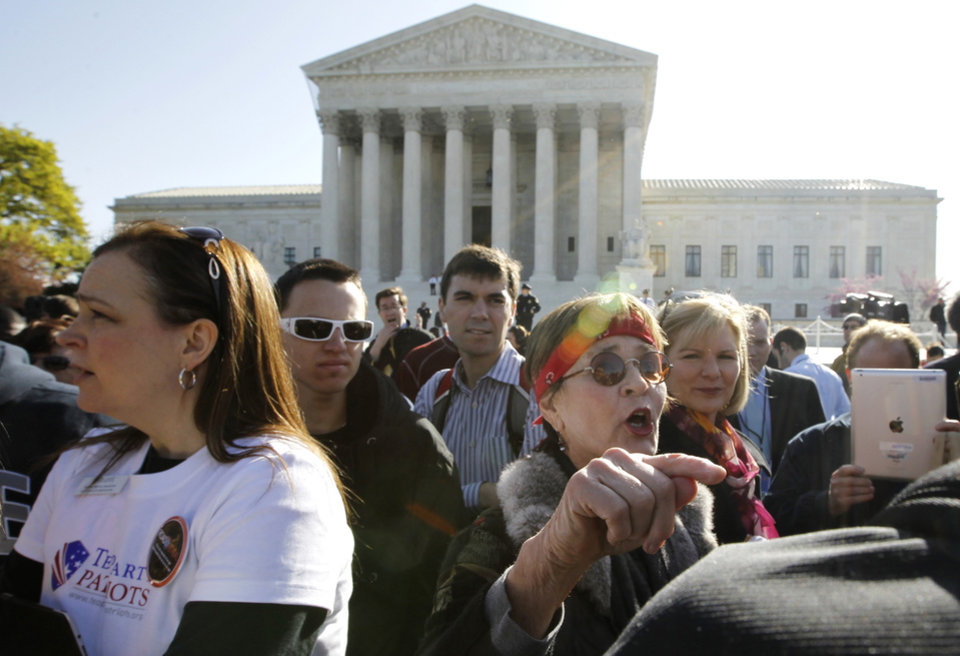 Linda Door of Laguna Beach, Calif., right, argues against the health care reform law as supporters file past the Supreme Court in Washington, Monday, March 26, 2012, as the court begins three days of arguments on health care. (AP Photo/Charles Dharapak) ORG XMIT: DCCD109