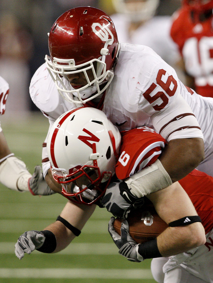 OU's Ronnell Lewis brings down Nebraska's Tim Marlowe during the Big 12 football championship game between the University of Oklahoma Sooners (OU) and the University of Nebraska Cornhuskers (NU) at Cowboys Stadium on Saturday, Dec. 4, 2010, in Arlington, Texas.  Photo by Bryan Terry, The Oklahoman