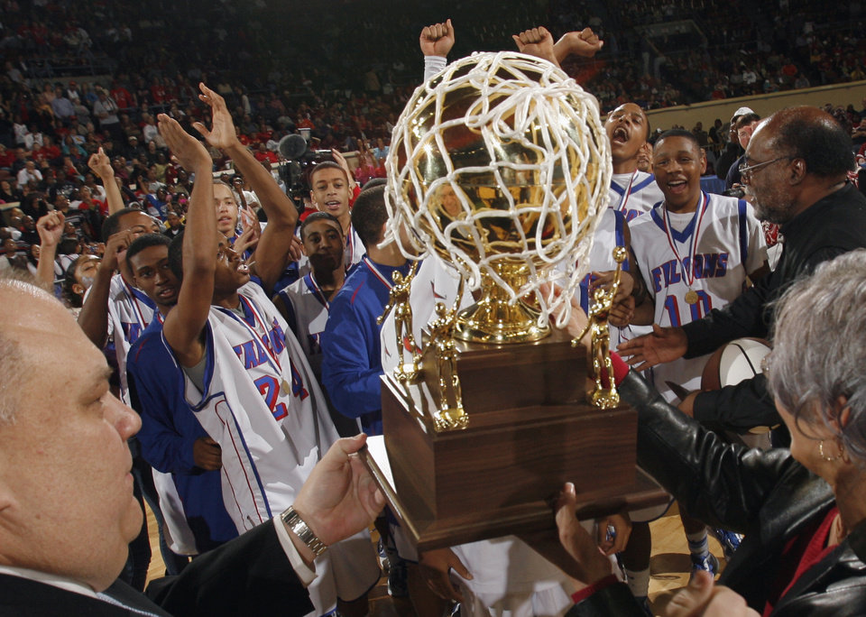 Millwood players accept the championship trophy after defeating Hugo in the Class 3A boys high school basketball state tournament finals at the State Fair Arena on Saturday, March 13, 2010, in Oklahoma City, Okla. Photo by Steve Sisney, The Oklahoman
