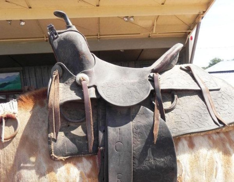 Photo - A saddle is among several artifacts and collectibles from the 101 Ranch and its Wild West Show to be auctioned Saturday.   - PROVIDED BY ARBUCKLE WILDERNESS