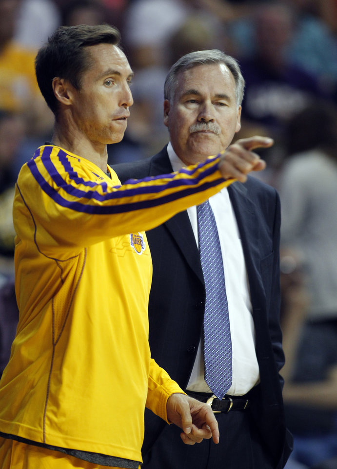 Photo - Los Angeles Lakers guard Steve Nash, left, talks with Lakers coach Mike D'Antoni in the second quarter during an NBA basketball preseason game against the Golden State Warriors Saturday, Oct. 5, 2013, in Ontario, Calif.  (AP Photo/Alex Gallardo)
