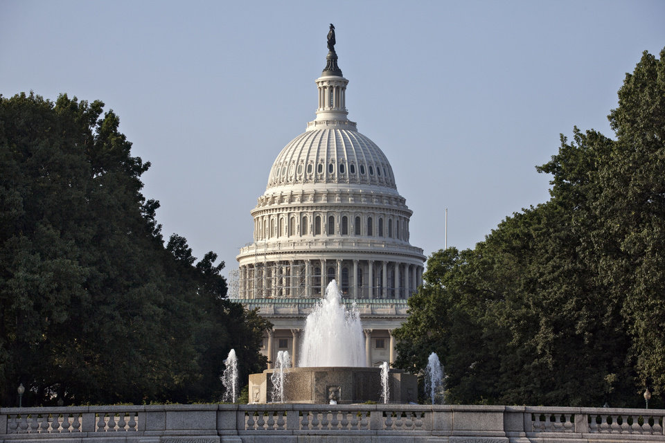 Photo - The Capitol is seen in Washington, Thursday morning, July 31, 2014, as lawmakers prepare to begin a five-week summer recess. Republicans pushed a divided House yesterday toward a campaign-season lawsuit against President Barack Obama, accusing him of deliberately exceeding the bounds of his constitutional authority. Obama and other Democrats derided the effort as a stunt aimed at tossing political red meat to conservative voters.  (AP Photo/J. Scott Applewhite)
