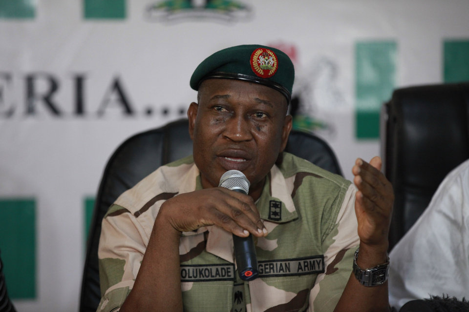 Photo - Brig. Gen. Chris Olukolade, Nigeria's top military spokesman, speaks during a press conference on the abducted school girls in Abuja, Nigeria, Monday, May 12, 2014. A Nigerian Islamic extremist leader says nearly 300 abducted schoolgirls will not be seen again until the government frees his detained fighters. A new video from Nigeria's homegrown Boko Haram terrorist network received Monday purports to show some of the girls and young women chanting Quranic verses in Arabic. The barefoot girls look frightened and sad and sit huddled together wearing gray Muslim veils. Some Christians among them say they have converted to Islam. (AP Photo/Sunday Alamba)