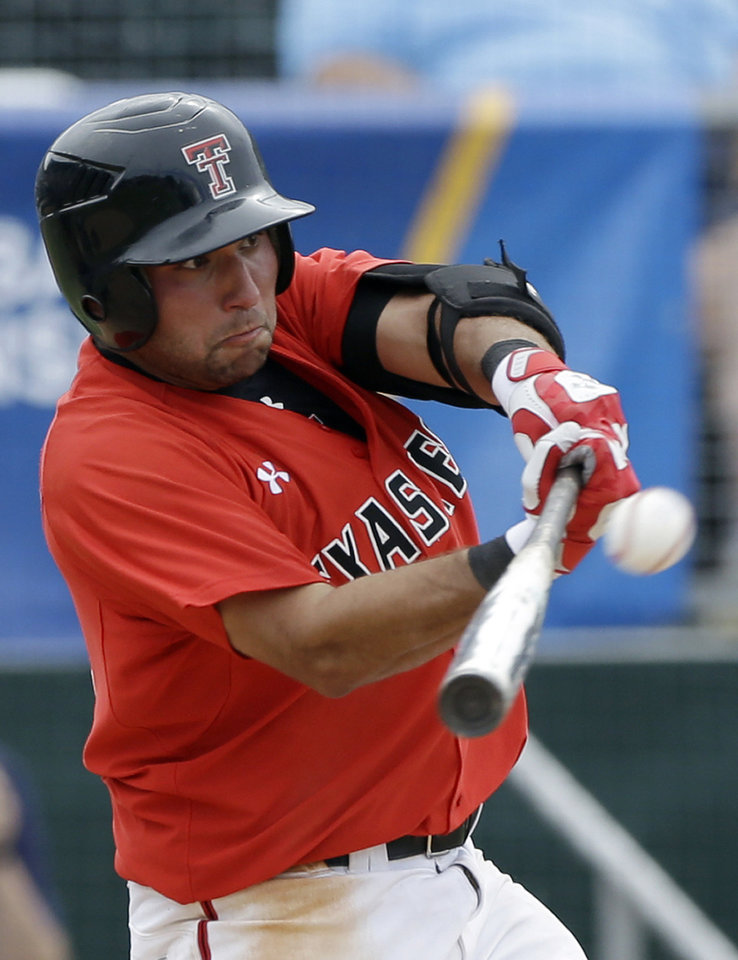 Photo - Texas Tech's Eric Gutierrez (12) doubles and drives in Zach Davis with the game-winning run against Columbia during the ninth inning of an NCAA college baseball regional tournament game in Coral Gables, Fla., Friday, May 30, 2014. Texas Tech won 3-2. (AP Photo/Alan Diaz)
