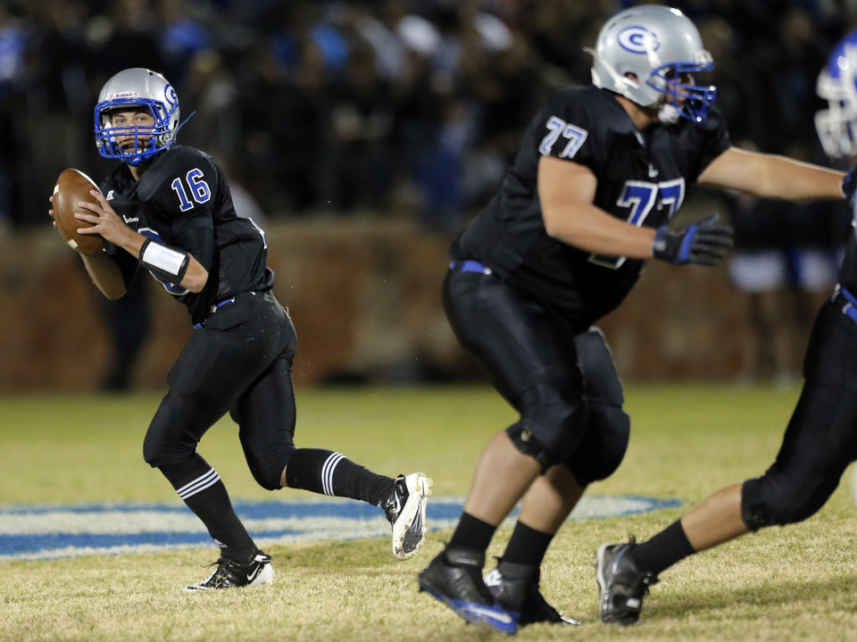 Photo - Guthrie's Bryan Dutton looks to pass the ball during the high school football game between Guthrie and Deer Creek at Guthrie, Thursday, Oct. 18, 2012. Photo by Sarah Phipps, The Oklahoman