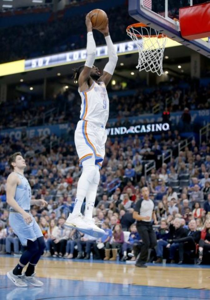 Photo -  Oklahoma City's Nerlens Noel goes up for a dunk after a steal during Thursday night's game against the Memphis Grizzlies. Memphis won, 110-97. [Sarah Phipps/The Oklahoman]