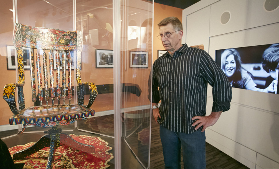 Photo - In this Friday, May 9, 2014 photo, Grammy Museum Executive Director Bob Santelli comments on The Mamas & the Papas singer Cass Elliot's chair, left, on display at the Grammy Museum exhibit
