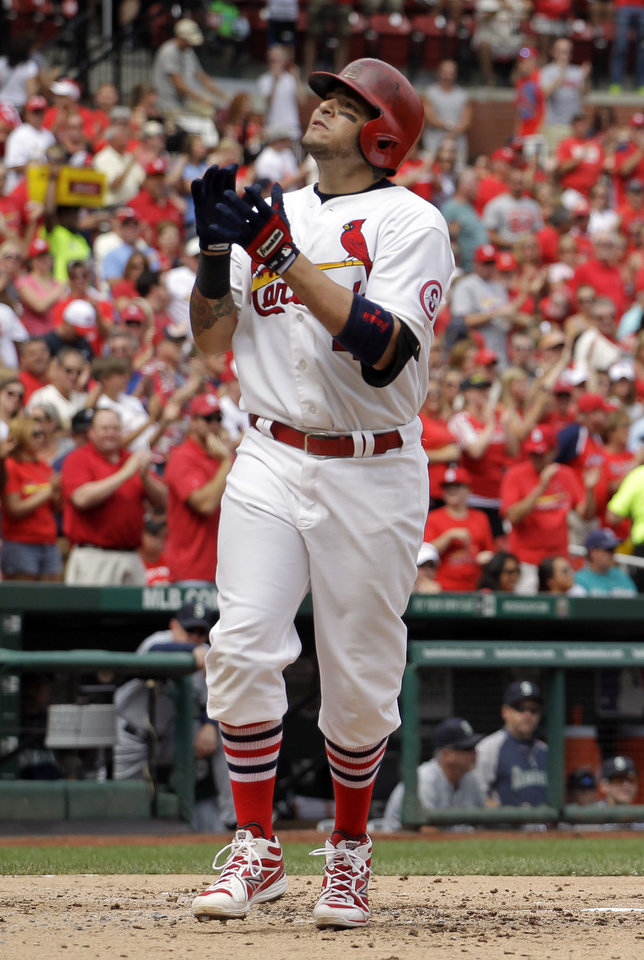 Photo - St. Louis Cardinals' Yadier Molina celebrates as he reaches home after hitting a solo home run during the second inning of a baseball game against the Seattle Mariners Sunday, Sept. 15, 2013, in St. Louis. (AP Photo/Jeff Roberson)