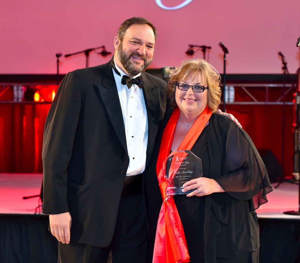 Photo -  The 23rd Annual Red Tie Night benefiting the Oklahoma AIDS Care Fund was March 7 at the Cox Convention Center. From left, Dr. David Chansolme, Oklahoma AIDS Care Fund board president, and Gaila Smalley, recipient of the annual Richard May Award, were among the attendees. Photo provided
