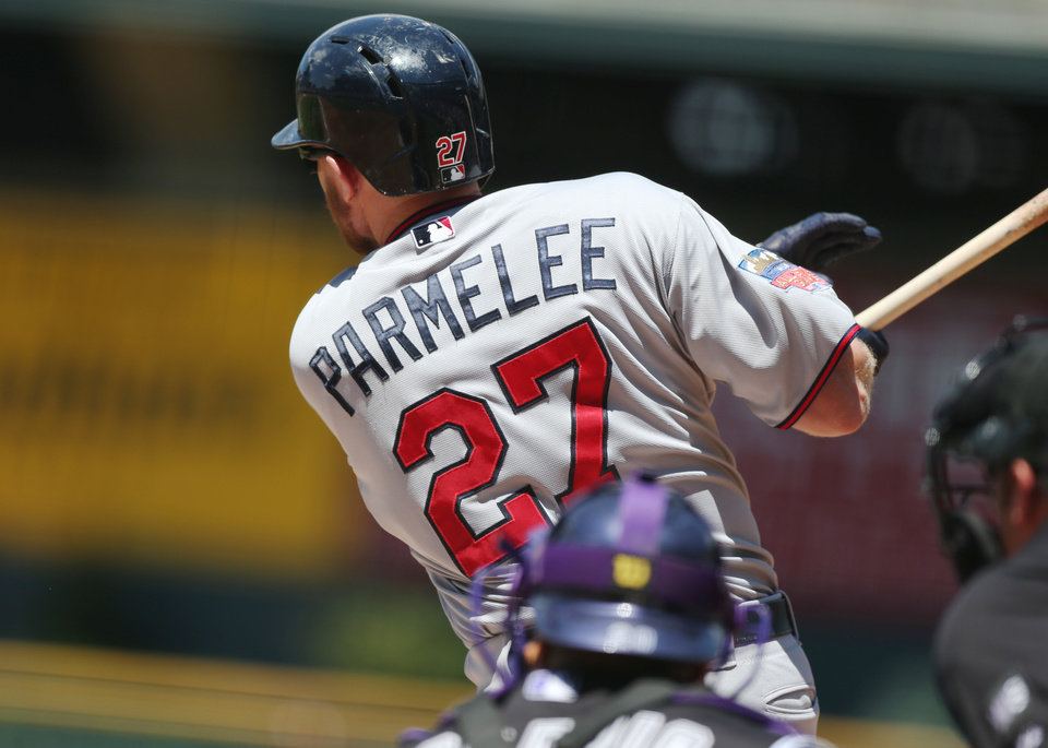 Photo - Minnesota Twins' Chris Parmelee singles to drive in two runs against the Colorado Rockies in the first inning of an interleague baseball game in Denver on Sunday, July 13, 2014. (AP Photo/David Zalubowski)